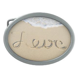 Love carved sign on the beach sand belt buckle