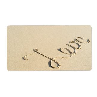 Love carved sign on the beach sand label