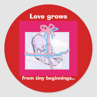 Love grows from tiny beginnings.. classic round sticker