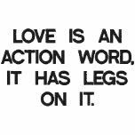 LOVE IS AN ACTION WORD, IT HAS LEGS ON IT. EMBROIDERED SHIRT