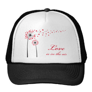 Love is in the air, dandelion with red hearts trucker hats