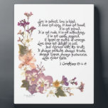 "Love is patient plaque<br><div class=""desc"">Love is patient,  love is kind...  1 Corinthians 13:4-8,  popular and beloved biblical passage heard especially at weddings and anniversaries,  presented here with pressed flowers and calligraphy by Simone Sheppard.  Flowers from her garden include linaria,  azalea,  pansy and larkspur. Beautiful gift for anyone.</div>"