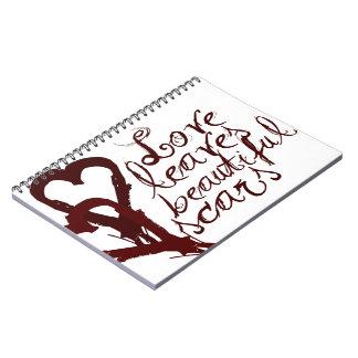 Love leaves beautiful scars notebooks