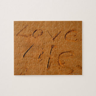 'Love Life' written in Sand Jigsaw Puzzles