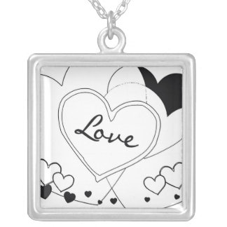 """""""love"""" on black and white hearts necklace"""