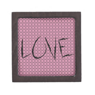 Love On Pink Background With Linked Rings Gift Box