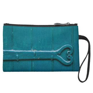 Love on the wall suede wristlet