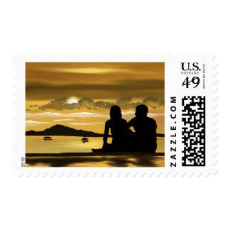 Love romantic unset on the beach postage