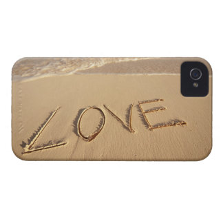 'Love' sand written on the beach with incoming Case-Mate iPhone 4 Case