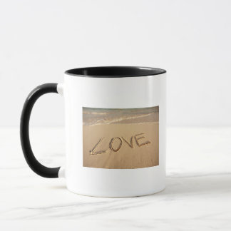 'Love' sand written on the beach with incoming Mug