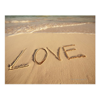 'Love' sand written on the beach with incoming Postcard