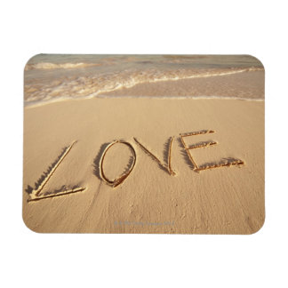 'Love' sand written on the beach with incoming Flexible Magnets
