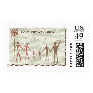 Love thy cavemen neighbor stamp