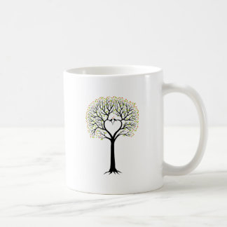 Love tree with heart branches, birds and hearts coffee mug