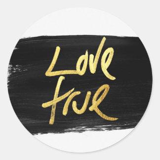 """Love True"" Gold on Black Brush Stroke Classic Round Sticker"