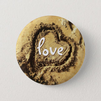 """Love you"" quote heart drawn in gold sand photo Button"