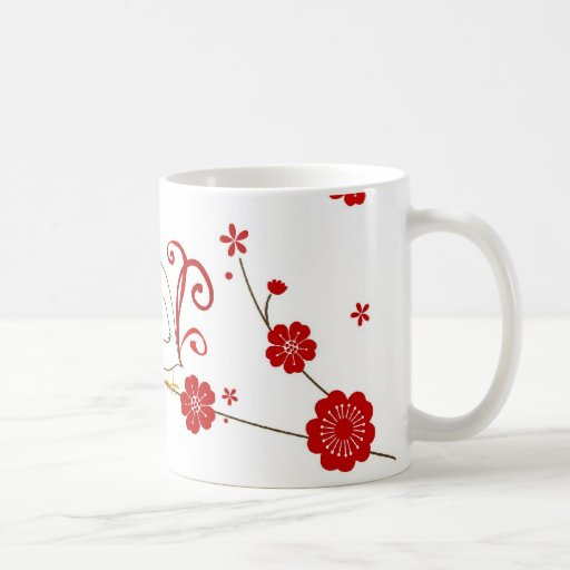 Lovebirds y taza de las flores de cerezo