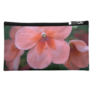 lovely common pink garden flowers. floral nature makeup bag