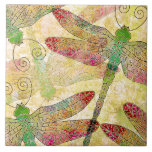 """Lovely Dragonfly Swarm Decorative Ceramic Tile<br><div class=""""desc"""">This decorative ceramic tile features a lovely, artistic pattern of overlapping dragonflies in rainbow colors over a gold background. Makes a wonderful gift for dragonfly lovers. Use as a home accent, or turn into a trivet or a keepsake box with our easy, custom options. Can be personalized too. Just click...</div>"""