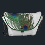 "Lovely Peacock Feathers with White Messenger Bag<br><div class=""desc"">These two peacock feathers are so beautiful.  The white background makes the green and blue colors of the feather look amazing.  Fun gift idea for a bird lover.</div>"