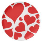 Lovely red hearts on white plate
