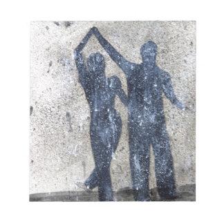 Lovers dancing in rain notepad