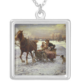 Lovers in a sleigh silver plated necklace