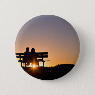 Lovers together at sunset button