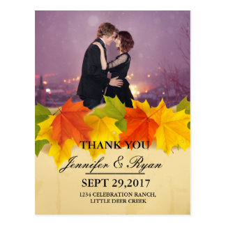 Loving couple dancing in the night city/fall theme postcard