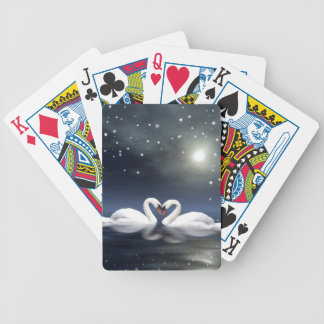 Loving swans playing cards