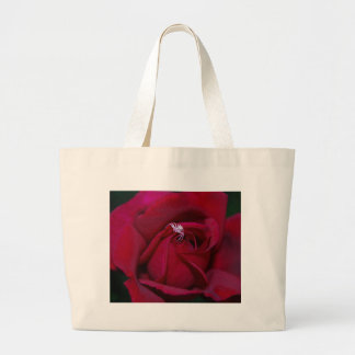 Loving the red rose and meaning tote bags