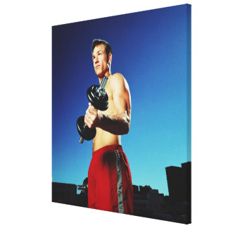low angle of a man in shorts working out with a canvas print
