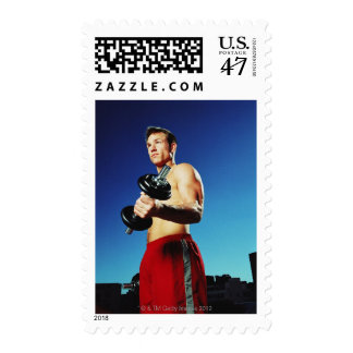 low angle of a man in shorts working out with a stamp