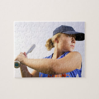 Low angle side view of a softball player looking jigsaw puzzle