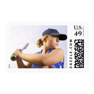 Low angle side view of a softball player looking stamps