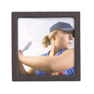 Low angle side view of a softball player looking premium jewelry boxes