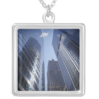 Low angle upward exterior view of downtown 2 silver plated necklace