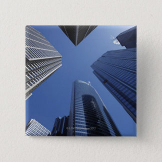 Low angle upward exterior view of downtown pinback button