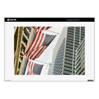 """Low angle view at American flags in downtown 15"""" Laptop Skin"""