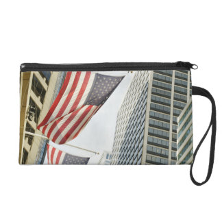 Low angle view at American flags in downtown Wristlet Purse