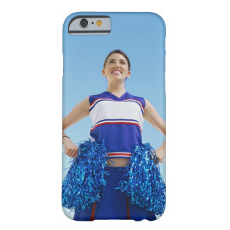 Low angle view of a cheerleader holding her barely there iPhone 6 case