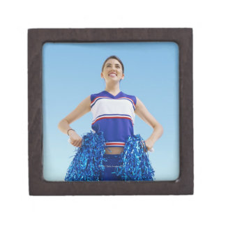 Low angle view of a cheerleader holding her gift box