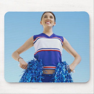 Low angle view of a cheerleader holding her mouse pad