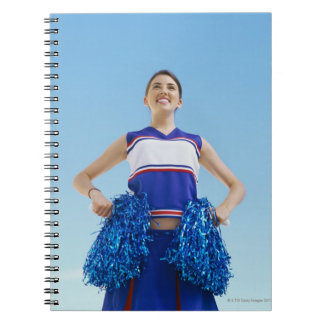 Low angle view of a cheerleader holding her notebooks