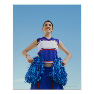 Low angle view of a cheerleader holding her poster