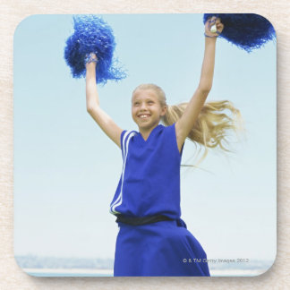 low angle view of a cheerleader holding up beverage coaster