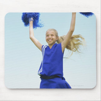low angle view of a cheerleader holding up mouse pad