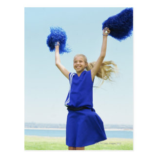 low angle view of a cheerleader holding up postcard