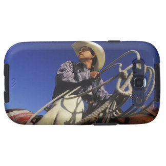 Low angle view of a cowboy riding a horse, samsung galaxy SIII covers