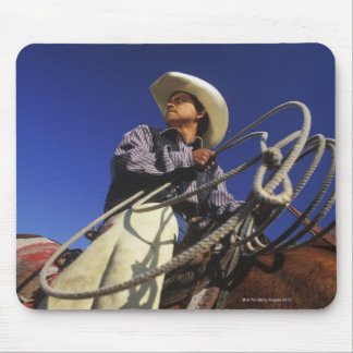 Low angle view of a cowboy riding a horse, mouse pad